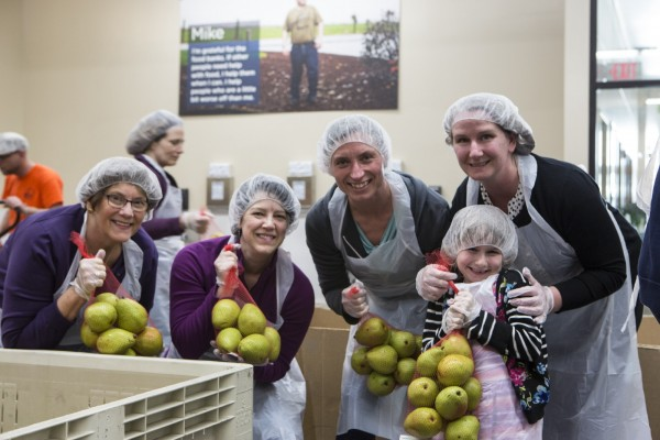 NWP Board Chair Maxine Dexter (center) and other NWP employees volunteer at the Oregon Food Bank.